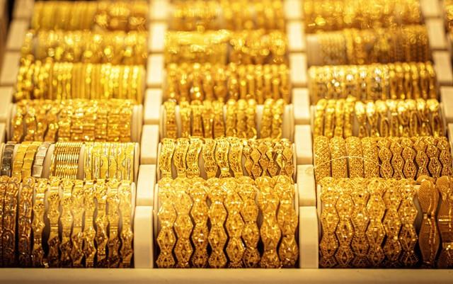 Giá vàng thế giới tuần qua tăng mạnh nhất kể từ giữa tháng 12/2020  - Ảnh 1.