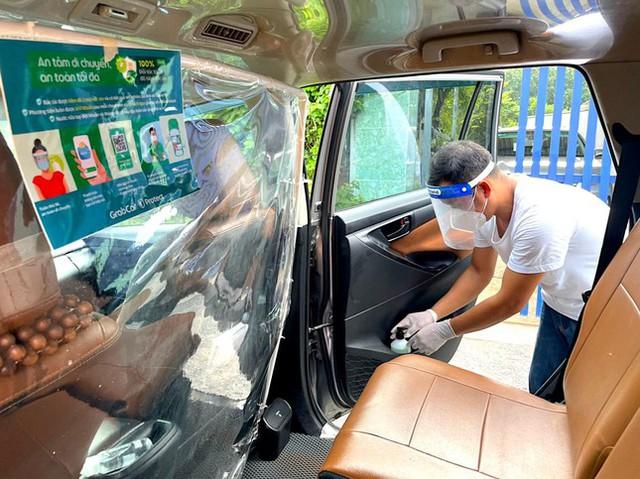 Grab mở lại dịch vụ GrabCar tại Hà Nội - Ảnh 2.