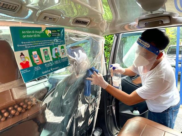 Grab mở lại dịch vụ GrabCar tại Hà Nội - Ảnh 3.