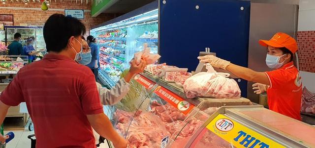 Thịt heo bình ổn thị trường giảm giá 10.000 đồng/kg  - Ảnh 1.