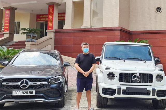 Cận cảnh hàng chục xe sang cùng lượng tiền mặt khủng vừa bị thu giữ trong đường dây đánh bạc ở Hà Nội - Ảnh 4.