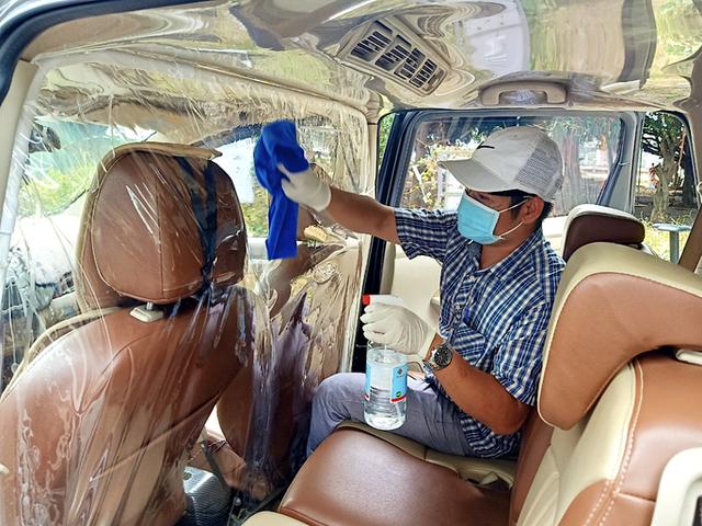 Hôm nay 7-10, taxi công nghệ GrabCar chính thức chạy lại ở TP HCM - Ảnh 1.