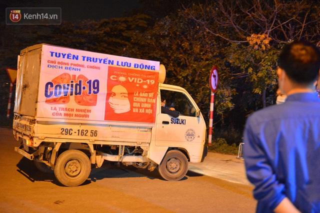 Hà Nội có thêm ca mắc Covid-19, hàng trăm người dân Mê Linh bất ngờ quay xe vì đường về nhà bị phong toả - Ảnh 14.