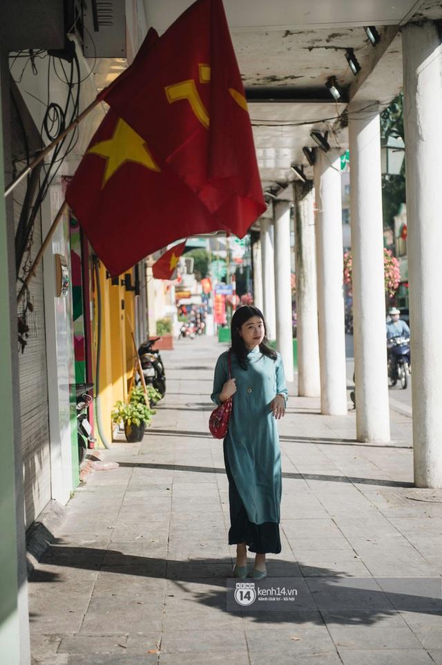 Chùm ảnh: Hà Nội đẹp nao lòng trong nắng ngày 30 Tết - Ảnh 13.
