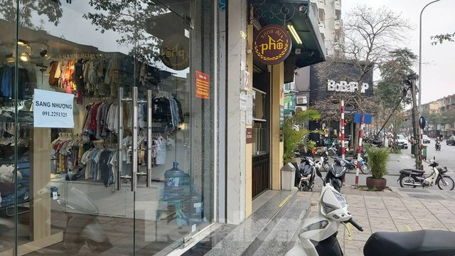 Hàng loạt khách sạn, cửa hàng Hà Nội treo biển cho thuê sau Tết - Ảnh 4.