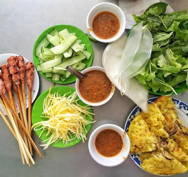 Các điểm đến có nền ẩm thực đặc sắc nhất Việt Nam: Hà Nội và Sài Gòn lọt top, loạt vùng biển cũng được kể tên - Ảnh 11.