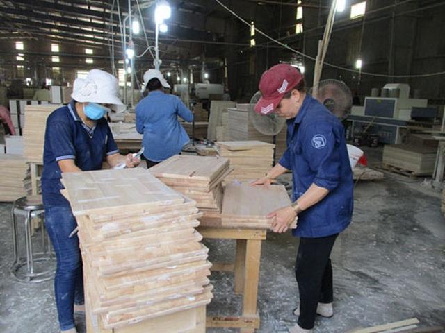 Ngành gỗ miệt mài xuất khẩu - Ảnh 1.