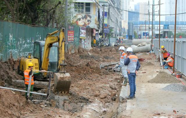 Tăng tốc thi công hầm chui đường bộ nút giao Lê Văn Lương - Khuất Duy Tiến - Ảnh 4.