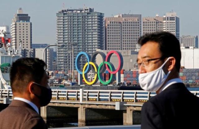 Quan chức Nhật Bản cảnh báo khả năng hủy Olympic Tokyo - Ảnh 1.