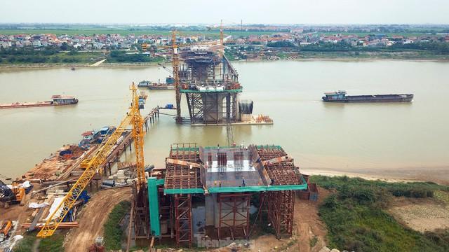 Toàn cảnh công trường xây dựng cầu vượt sông gần 2.000 tỷ đồng ở Bắc Ninh  - Ảnh 11.