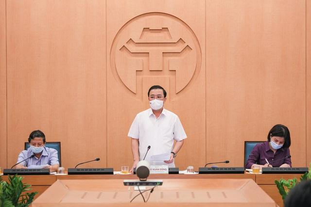 50 người tiếp xúc gần với 2 ca dương tính SARS-CoV-2 ở Hà Nội  - Ảnh 1.