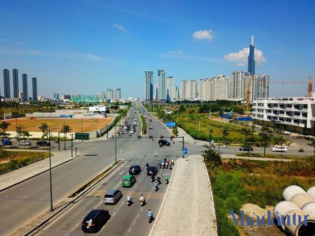 Hạ tầng giao thông đang mở lối cho bất động sản vùng TP.HCM mở rộng - Ảnh 1.