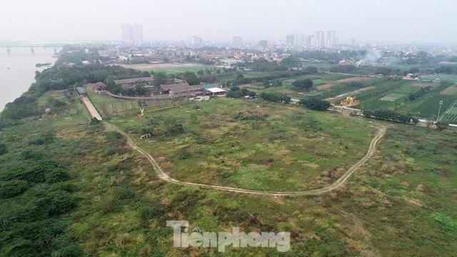 Thủ tướng chỉ đạo xử lý tình trạng chiếm đất ăn theo quy hoạch sông Hồng - Ảnh 1.