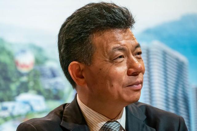 Bất chấp nợ nần, một gia tộc Trung Quốc đang âm thầm thâu tóm bất động sản để bám sóng đầu cơ - Ảnh 1.