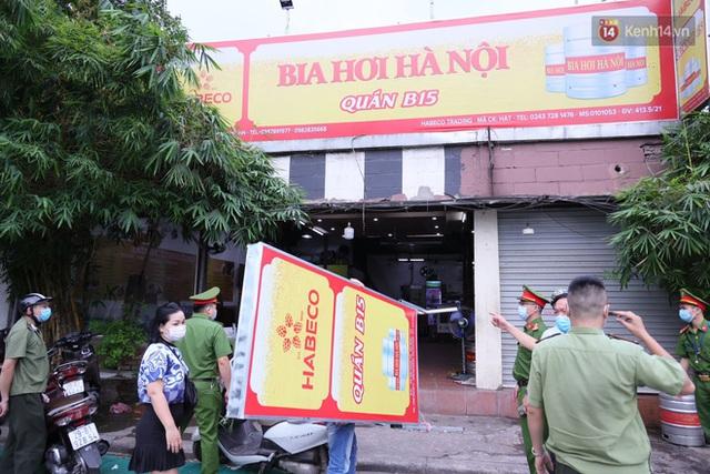Hà Nội: Lực lượng chức năng ra quân tuyên truyền người dân dừng bán bia hơi và chợ cóc để phòng dịch Covid-19 - Ảnh 14.