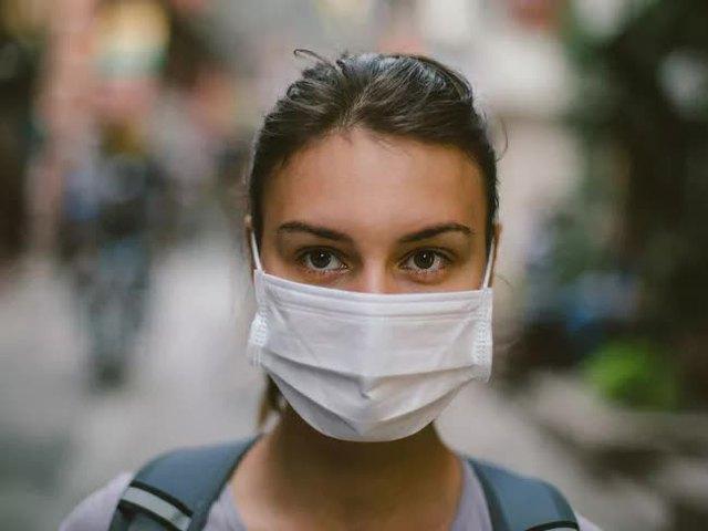 Chuyên gia nói gì trước thông tin người dân Mỹ không cần đeo khẩu trang khi đã tiêm phòng vaccine Covid-19 đầy đủ? - Ảnh 3.