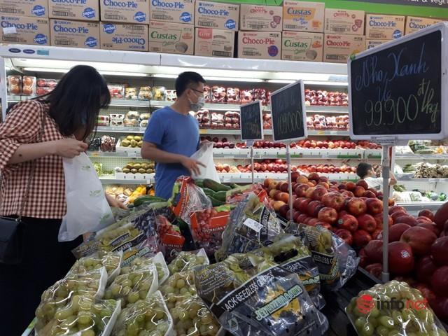 Hà Nội: Dân đổ xô về quê, đi chơi ngày lễ, siêu thị vắng khách, chợ ế hàng - Ảnh 7.