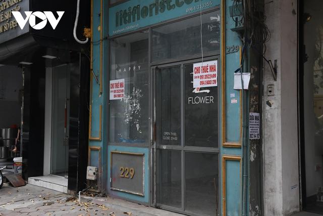 Hình ảnh các cửa hàng kinh doanh tại Hà Nội đóng cửa vì dịch Covid-19 - Ảnh 14.