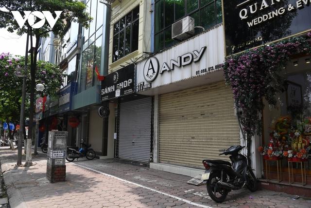 Hình ảnh các cửa hàng kinh doanh tại Hà Nội đóng cửa vì dịch Covid-19 - Ảnh 15.