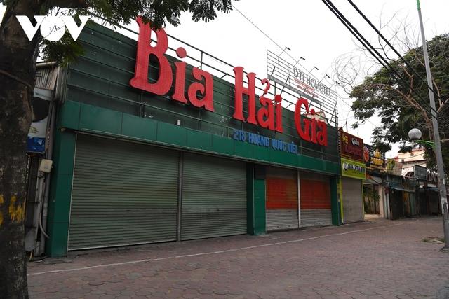 Hình ảnh các cửa hàng kinh doanh tại Hà Nội đóng cửa vì dịch Covid-19 - Ảnh 4.