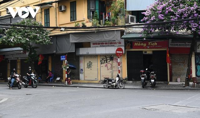 Hình ảnh các cửa hàng kinh doanh tại Hà Nội đóng cửa vì dịch Covid-19 - Ảnh 5.
