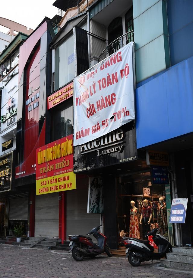 Hình ảnh các cửa hàng kinh doanh tại Hà Nội đóng cửa vì dịch Covid-19 - Ảnh 7.
