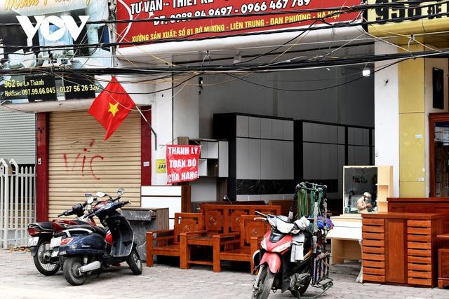 Hình ảnh các cửa hàng kinh doanh tại Hà Nội đóng cửa vì dịch Covid-19 - Ảnh 9.