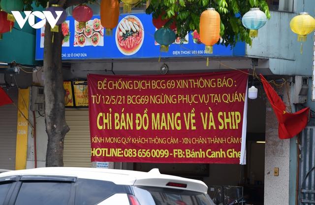Hình ảnh các cửa hàng kinh doanh tại Hà Nội đóng cửa vì dịch Covid-19 - Ảnh 10.