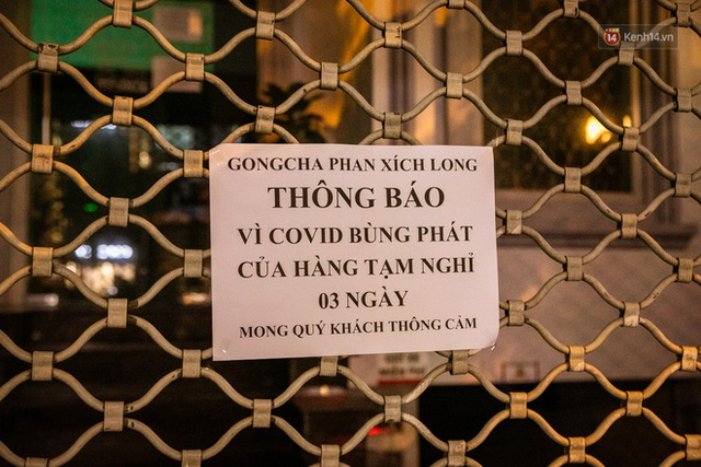 Quán xá Sài Gòn lao đao giữa mùa dịch: Thông báo bán mang đi nhưng nhiều nơi vẫn vắng hoe, khung cảnh ảm đạm bao trùm nhiều tuyến phố - Ảnh 14.