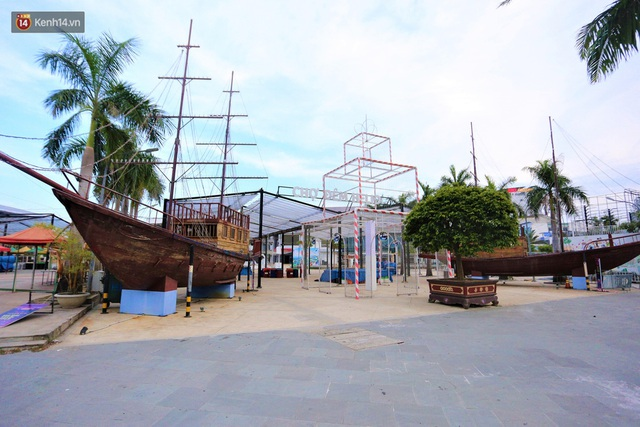 Ảnh: Bãi biển, khu vui chơi ở Đà Nẵng vắng bóng người trong ngày đầu siết chặt các biện pháp phòng, chống Covid-19 - Ảnh 17.