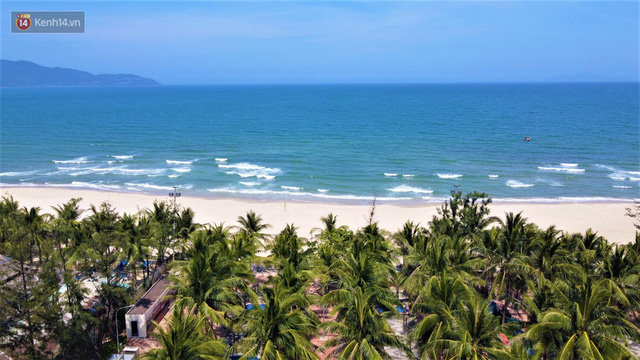 Ảnh: Bãi biển, khu vui chơi ở Đà Nẵng vắng bóng người trong ngày đầu siết chặt các biện pháp phòng, chống Covid-19 - Ảnh 8.