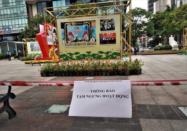 Phố đi bộ Nguyễn Huệ vắng lặng ngày giãn cách  - Ảnh 5.