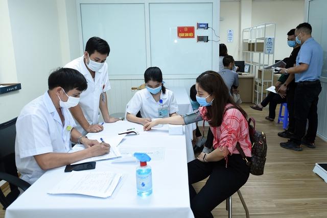 Vaccine COVID-19 đầu tiên của Việt Nam thử nghiệm giai đoạn 3 trên người  - Ảnh 1.