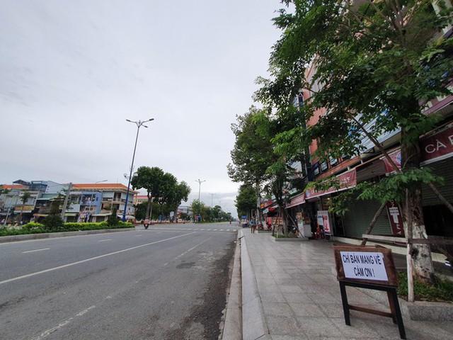 Cận cảnh Tiền Giang ngày đầu thực hiện giãn cách xã hội  - Ảnh 5.