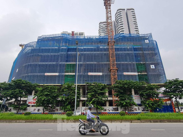 Bộ Xây dựng bãi bỏ loạt thủ tục hành chính liên quan đến nhà ở, bất động sản  - Ảnh 2.