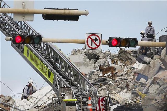 Các nguyên nhân có thể khiến tòa nhà 12 tầng ở Mỹ đổ sập - Ảnh 3.