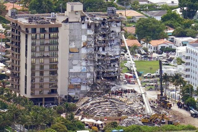 Vụ sập nhà chung cư Mỹ: Tăng số người thiệt mạng, 156 người vẫn mất tích - Ảnh 1.