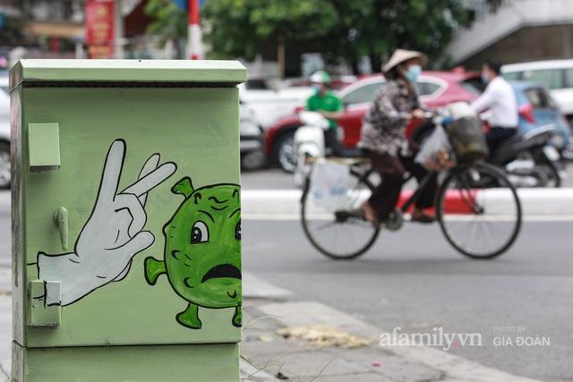 Bốt điện ở Hà Nội biến thành tác phẩm nghệ thuật đường phố tôn vinh các chiến sĩ áo trắng chống dịch - Ảnh 11.