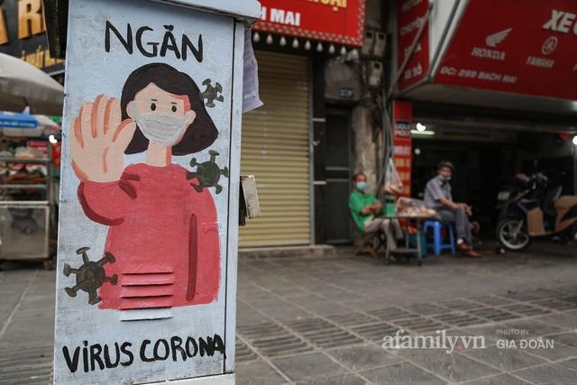 Bốt điện ở Hà Nội biến thành tác phẩm nghệ thuật đường phố tôn vinh các chiến sĩ áo trắng chống dịch - Ảnh 3.