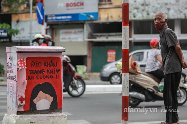Bốt điện ở Hà Nội biến thành tác phẩm nghệ thuật đường phố tôn vinh các chiến sĩ áo trắng chống dịch - Ảnh 4.