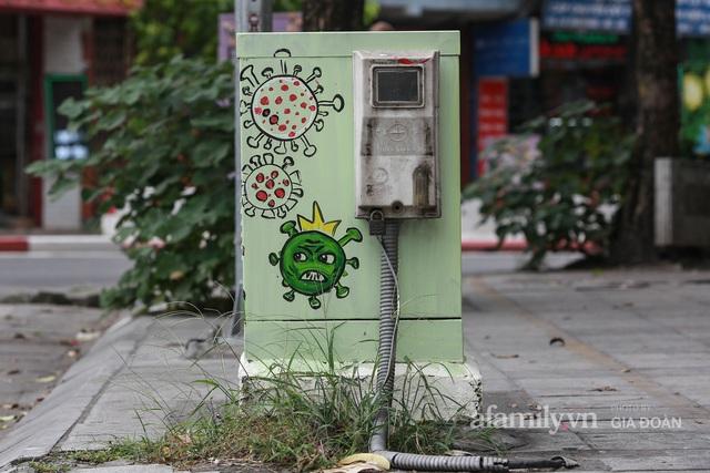 Bốt điện ở Hà Nội biến thành tác phẩm nghệ thuật đường phố tôn vinh các chiến sĩ áo trắng chống dịch - Ảnh 8.