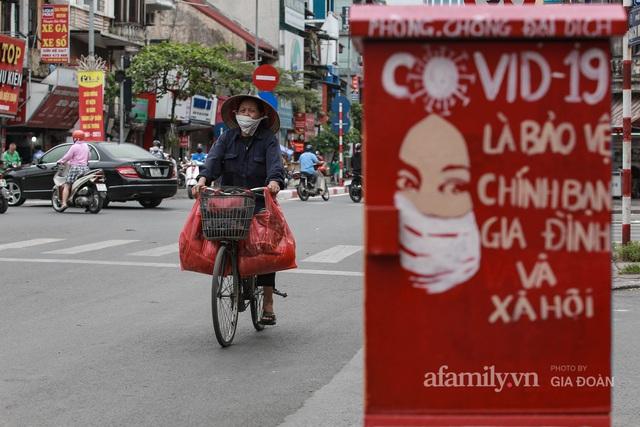 Bốt điện ở Hà Nội biến thành tác phẩm nghệ thuật đường phố tôn vinh các chiến sĩ áo trắng chống dịch - Ảnh 9.