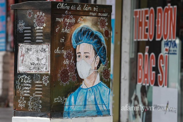 Bốt điện ở Hà Nội biến thành tác phẩm nghệ thuật đường phố tôn vinh các chiến sĩ áo trắng chống dịch - Ảnh 10.