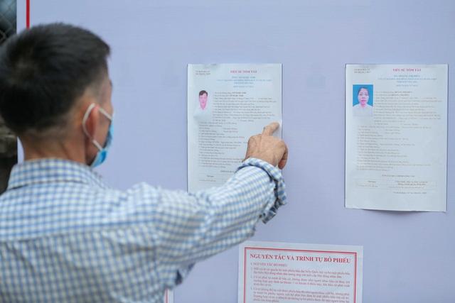 CLIP: Cận cảnh người dân đi bỏ phiếu lại sau khi có vi phạm  - Ảnh 6.