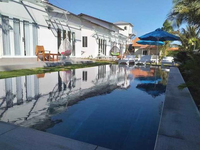 Phòng nghỉ nhà giàu villa, farmstay giá rẻ ngang nhà trọ, chủ mời khách đến ở cho có hơi người - Ảnh 1.