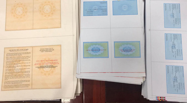 Phá đường dây làm giả giấy tờ ô tô, thu hàng loạt xe sang tiền tỷ - Ảnh 2.