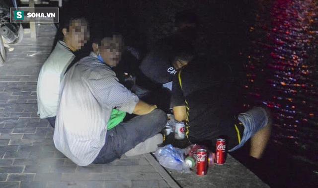 Hà Nội: Hàng trăm nam thanh nữ tú ra công viên tập thể dục, ăn nhậu, tâm sự thấy công an bỏ chạy toán loạn - Ảnh 9.