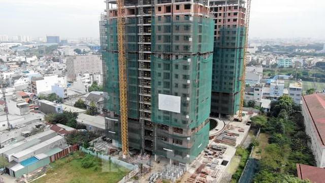 Xử nghiêm dự án không có bảo lãnh ngân hàng khi bán nhà hình thành trong tương lai  - Ảnh 1.