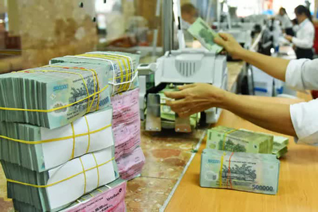 Doanh nghiệp đã được giảm lãi suất cho vay - Ảnh 1.