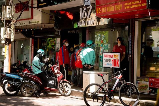 Shipper của bưu chính, siêu thị được hoạt động sau khi đăng ký với Sở GTVT Hà Nội  - Ảnh 1.